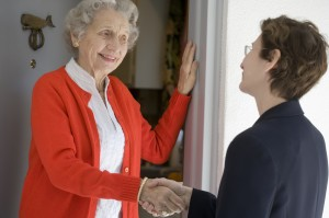 Senior woman at front door
