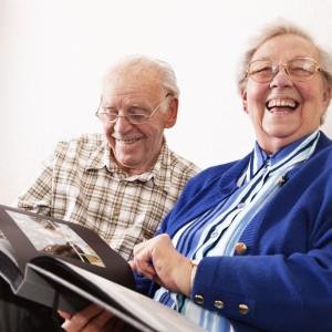 senior couple sharing happy memories at home